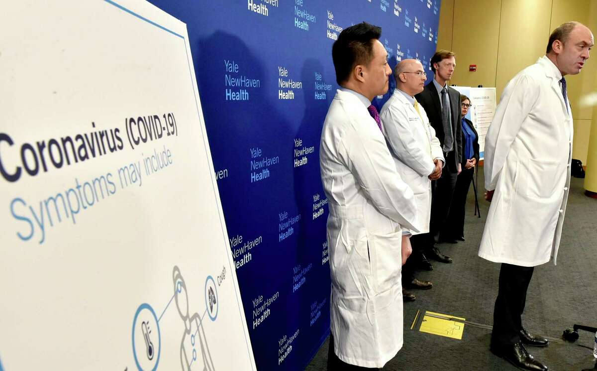 New Haven, Connecticut - Friday, March 13, 2020: Dr. Thomas Balcezak, MD, Yale New Haven Health Chief Medical Officer, right, speaks during a Yale New Haven Health press conference updating the pubic on its preparations on dealing with COVID-19 / Cornavirus. With Balcezak from left to right, rear, are Dr. Steven Choi, MD, Chief Quality Officer at Yale New Haven Health and Yale school of Medicine, Dr. Rick Martinello, MD, Medical Director of Infection Prevention at Yale New Haven Health, New Haven Mayor Justin Elicker, and Maritza Bond, New Haven Director of Public Health.