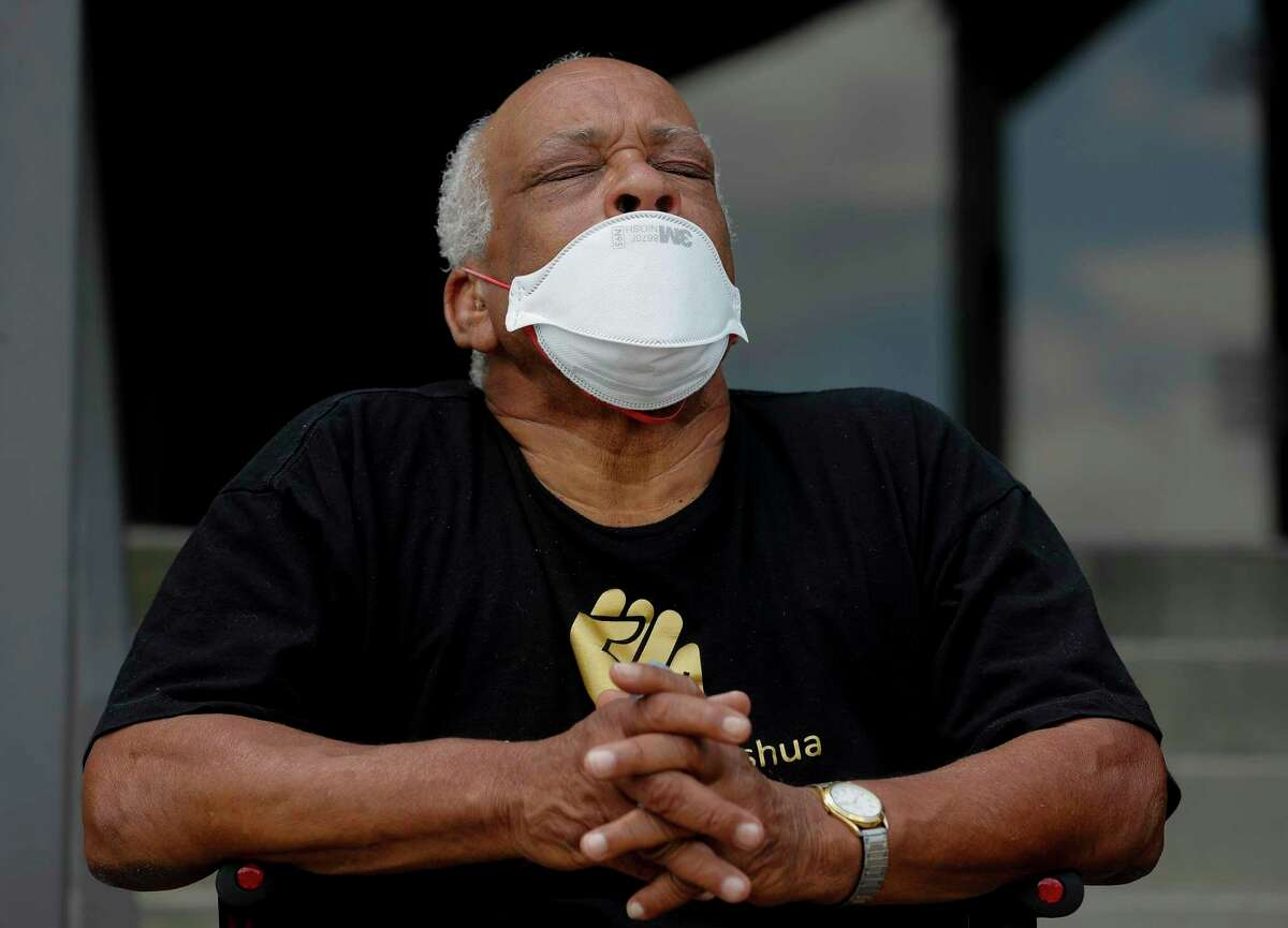 Richard Beary, father of Joshua Johnson, closes his eyes while listening to a recording of a conversation the family had with a Harris County Sheriff's Office detective the day of his son's death, during a press conference Wednesday, June 17, 2020, in Houston. Green met with Harris County Sheriff Ed Gonzalez and Johnson's family, who was killed by an unnamed, plain-clothes, undercover Harris County Sheriff's Office deputy on April 22, 2020.