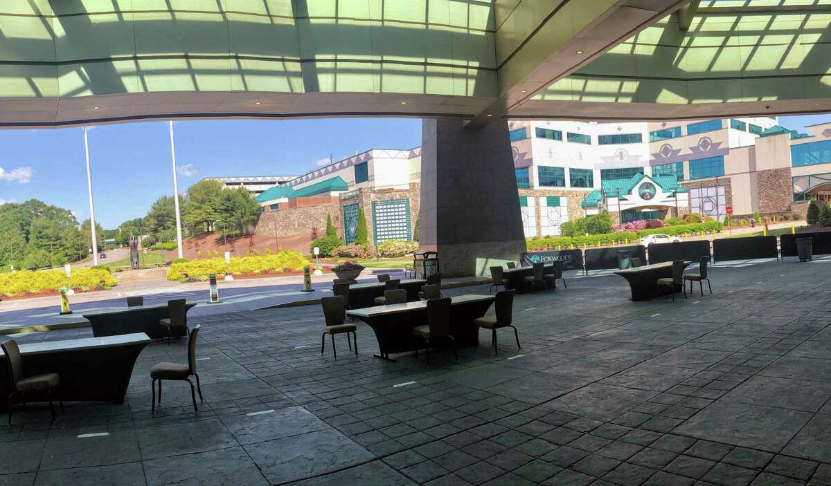 During June, tables and chairs were set up in the outdoor valet area of Foxwoods for takeout food, but officials were planning to remove them with the return of in-restaurant dining.