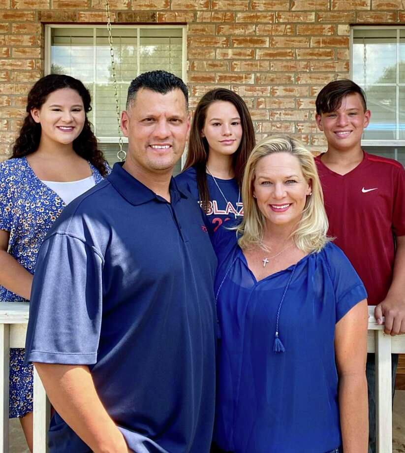 Christina Mata, front right, has been hired as the head softball coach at Dawson High School. Mata's family includes husband Sammy and (back row from left) daughters Alicia and Abella, and son Christian. Photo: Submitted Photo