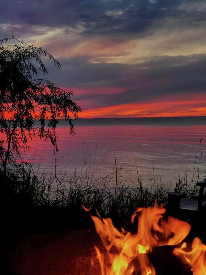 The perfect way to end a day is a campfire and the sunsets at Port Crescent State Park. (John Kippe/Courtesy Photo)