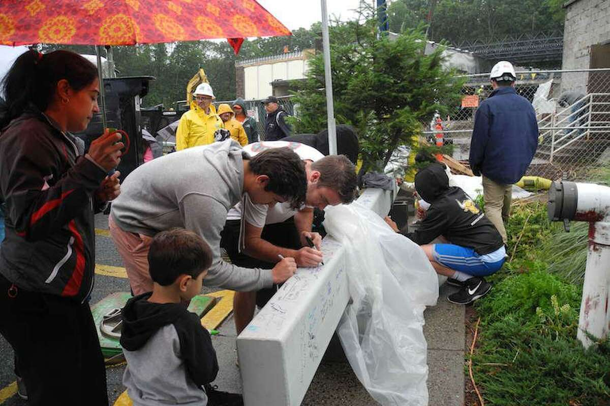 Last June, hundreds braved the rain to sign a steel beam that is now part of the YMCA building expansion.