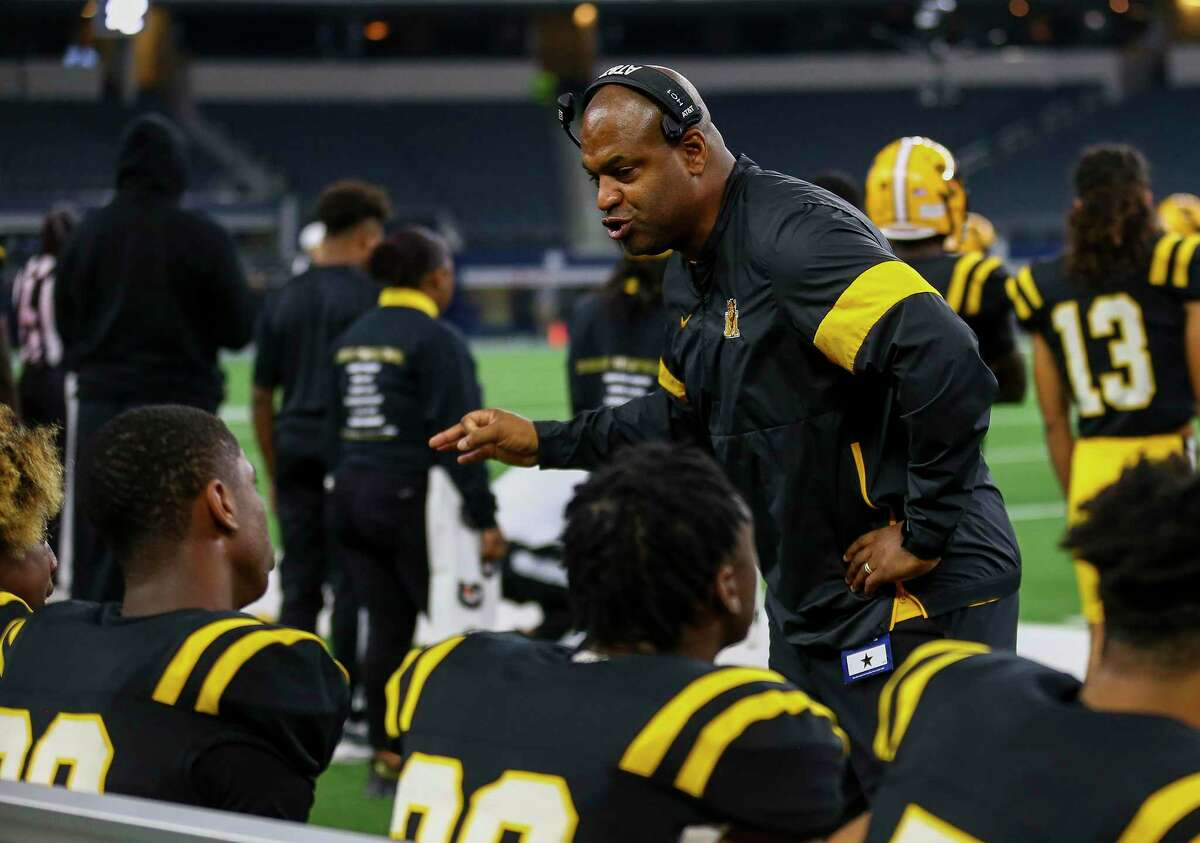 Fort Bend Marshall head coach James Williams talks to players on the sideline during last season's state championship game. The Buffs won their playoff opener this weekend in an effort to return.