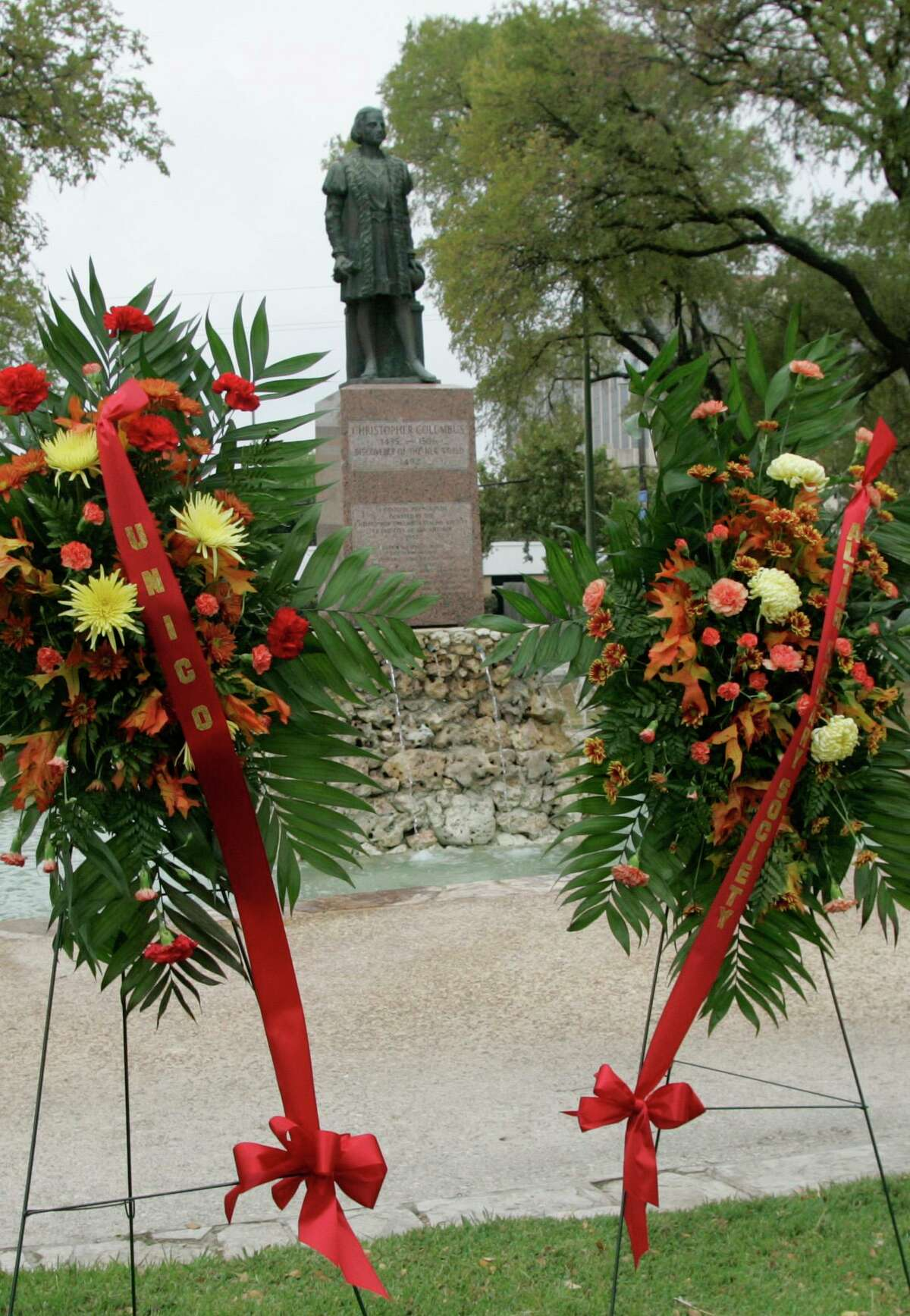Wreaths bracket the statue of Christopher Columbus at Columbus Park on the edge of downtown San Antonio on Sunday, Oct. 12, 2008, following the San Antonio Christopher Columbus Italian Society's celebration of the explorer's1492 voyage of discovery. A procession from San Francisco di Paola Catholic Church to the park next door ended with the wreath-laying ceremony at the statue.