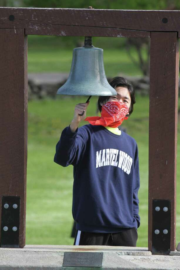 Marvelwood School in Kent recently held a virtual commencement exercise for its class of 2020. David Ma of Kent, student body president and valedictorian, ran the Piper Victory Bell in honor of all his classmates. Photo: Courtesy Of Marvelwood School / Danbury News Times Contributed