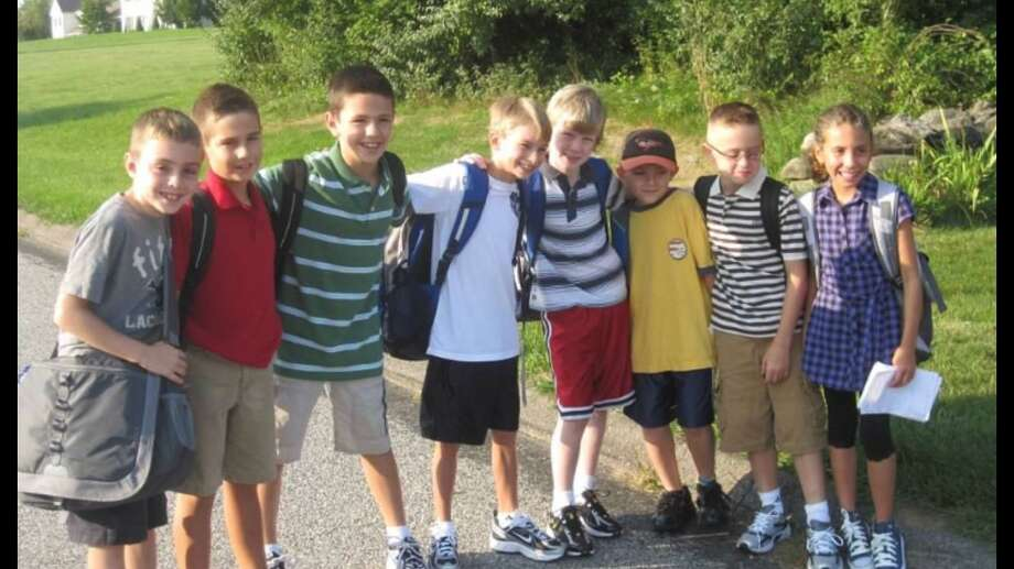 Above are, from left to right, Matt Bouzakis, Daniel Bologna, Zach Deakin, Jason Golembeski, Luke Anderson, Luke Foster, Luke Pliego and Maggie Pascento on their first day of elementary school. Photo: Courtesy Of The Pliegos / Danbury News Times Contributed