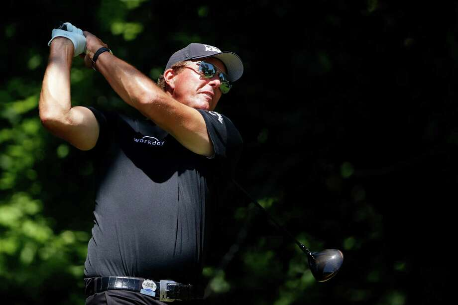 Phil Mickelson plays his shot from the sixth tee during the second round of the Charles Schwab Challenge on June 12 in Fort Worth, Texas. Mickelson committed Thursday to play in this year's Travelers Championship, which he won in 2001-02. Photo: Tom Pennington / Getty Images / 2020 Getty Images