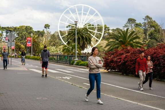 People maintain social distancing at Golden Gate Park during the shelter-in-place orders on Sunday, March 22, 2020 in San Francisco, California.