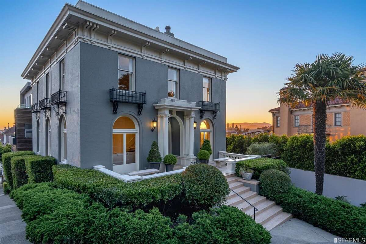 The home's facade is largely original, including the arched windows. In addition to the lush landscaping around the property, Buena Vista Park is just steps away.