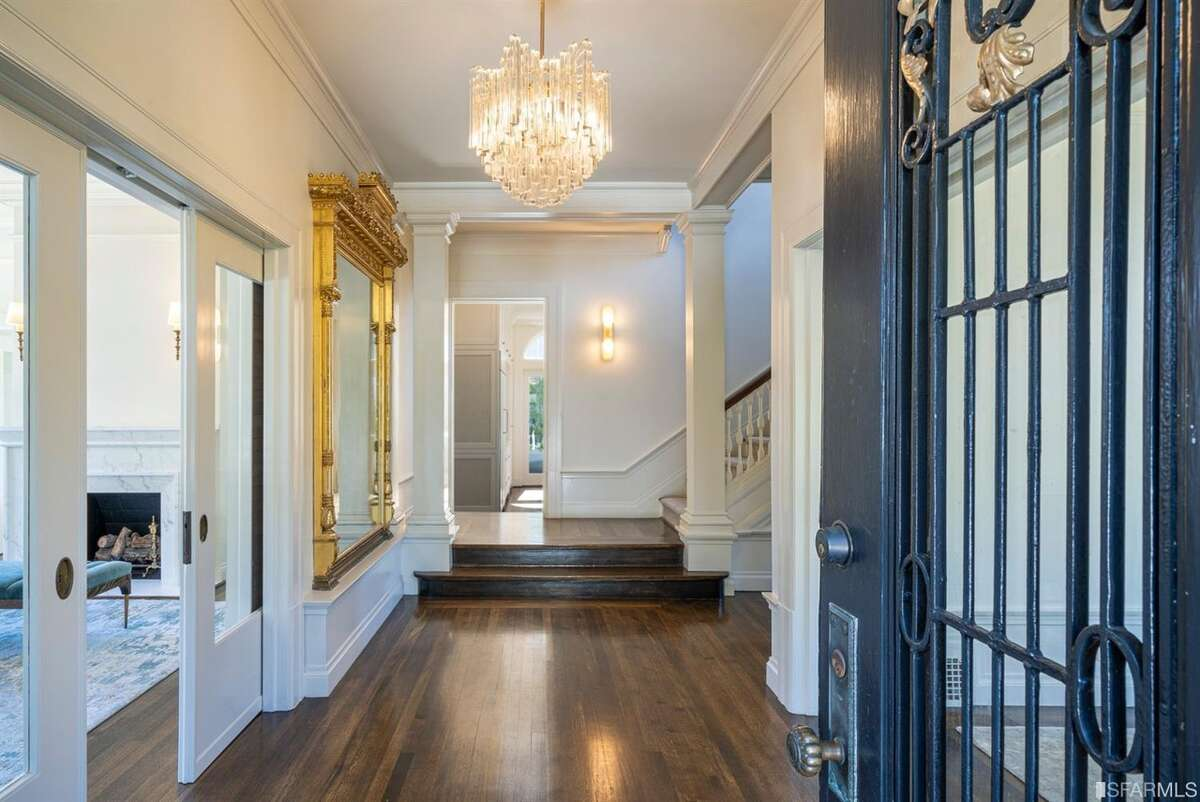 The grand entry with a custom Austrian chandelier also speaks to the home's 1913 vintage feel.