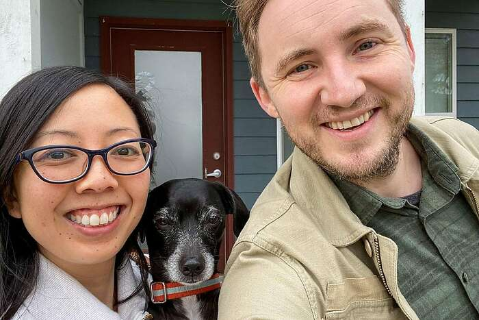 Chronicle reporter Kellie Hwang, her boyfriend Tristan Pereida-Rice and their dog Emmet in front of their previous 凯发k8旗舰厅app下载home in Indianapolis on March 24, 2020.