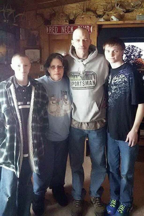 """From left, Brandon Ashbrook, Cindy Wilbur, Richard Ashbrook and Codey Ashbrook pose for a picture in this undated photo. Richard """"Ricky"""" Ashbrook's were recently found in a Pleasant Plains Township backyard. His disappearance his now turned into a homicide case. (Submitted Photo)"""