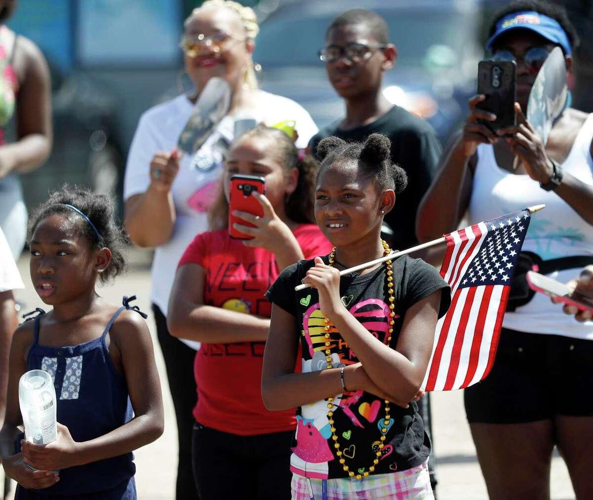 Kaya Davis, 10, holds her American flag during the annual Juneteenth Parade in Acres Homes, Saturday, June 16, 2018, in Houston. ( Karen Warren / Houston Chronicle )