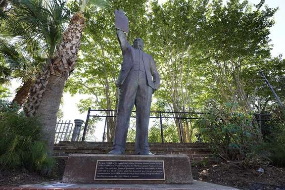 "In this June 17, 2020, photo, a statue depicts a man holding the state law that made Juneteenth a state holiday in Galveston, Texas. The inscription on the statue reads ""On June 19, 1865, at the close of the Civil War, U.S. Army General Gordon Granger issued an order in Galveston stating that the 1863 Emancipation Proclamation was in effect. That event, later known as ""Juneteenth,"" marked the end of slavery in Texas. Celebrated as a day of freedom since then, Juneteenth grew into an international commemoration and in 1979 became an official Texas holiday through the efforts of State Representative Albert (AL) Edwards of Houston."" (AP Photo/David J. Phillip)"