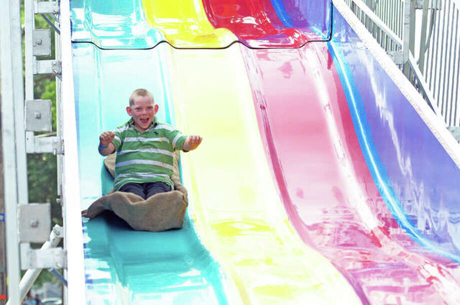 A youngster enjoys an attraction at the Madison County Fair in Highland last year. Officials have announced that this year's event will not be held because of pandemic health concerns. Photo: Intelligencer File Photo