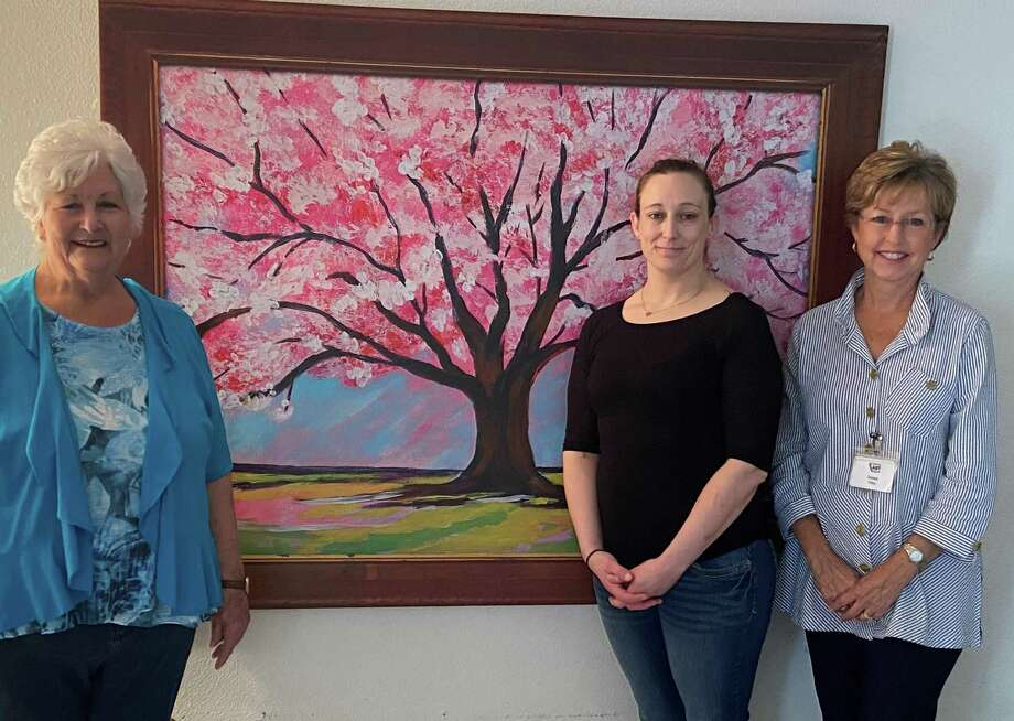 The Treehouse Center for girls in Conroe received an original artwork banner from an artist at the Conroe Art League. Pictured left to right are Linda Jackson, (artist), Carmie Horn, (Executive Director) and Debra Riley, (VP Conroe Art League). Photo: Courtesy Photo