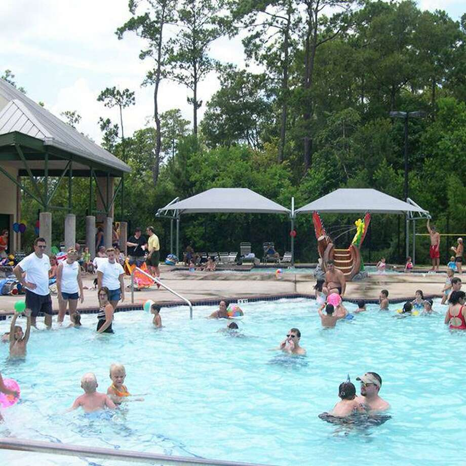 The Harper's Landing Community swimming pool in The Woodlands has closed for the remainder of the year due to difficulties with staffing and other issues related to the COVID-19 novel coronavirus pandemic. In this file photo, swimmers are shown at the Alden Bridge Community swimming pool, which is one of six pools that remain open to swimmers at 50 percent capacity. Photo: Courtesy Image / Courtesy Image