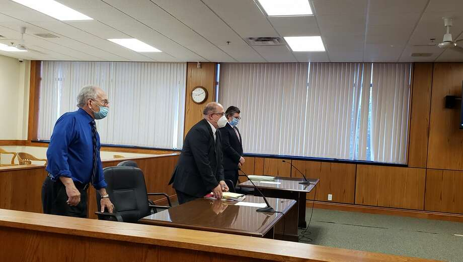 (From left) Denis Johnson, his attorney Patrick Dougherty and Assistant Attorney General Bryant Osikowicz were present for a court appearance Wednesday morning to address Johnson's motion to withdraw his guilty plea in 19th Circuit Court. Photo: Arielle Breen/News Advocate