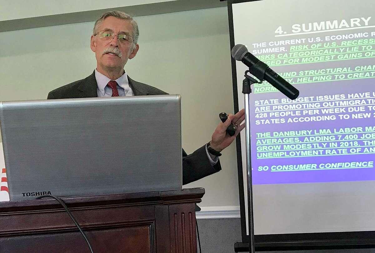 Economist Don Klepper-Smith, right, speaks during the Greater Danbury Chamber of Commerce's 2018 Economic Forecast Breakfast in Danbury, Conn.