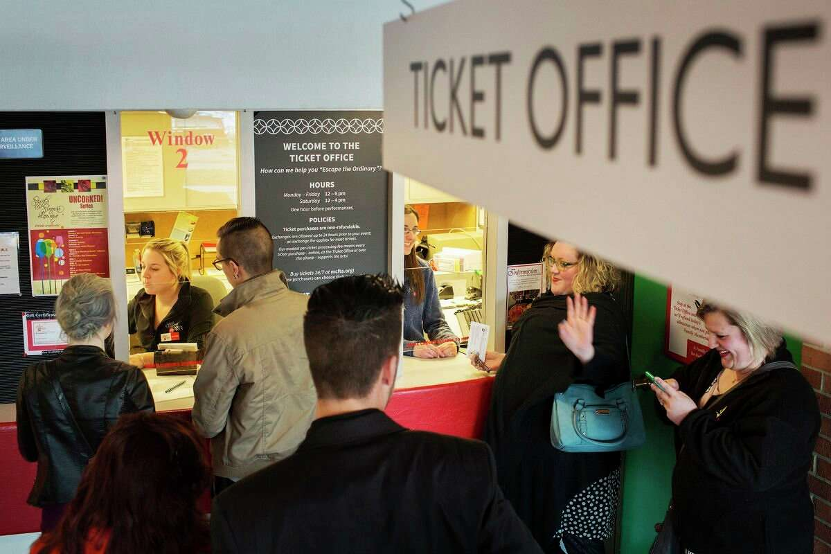 FILE - Midland Center for the Arts employees Sam Johnson, left, and Nicole Toth, right, manage the ticket office for customers waiting to see the production of The Mystery of Edwin Drood at the Center Stage Theatre and The Midland Symphony Orchestra in April of 2016. (Theophil Syslo/Daily News file)