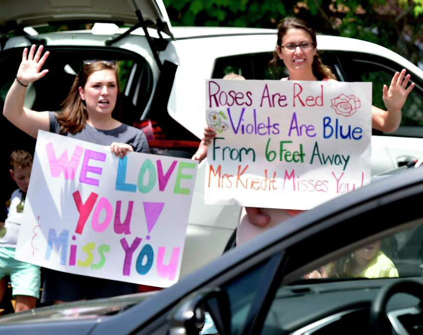 New Haven, Connecticut -Thursday, June 18, 2020: Mauro-Sheridan Magnet School teachers give a summer vacation sendoff to their pre-kindergarten through their graduating eighth-grade students with a drive-by gathering Thursday afternoon at the New Haven School. Approximately 540 students attend the school.