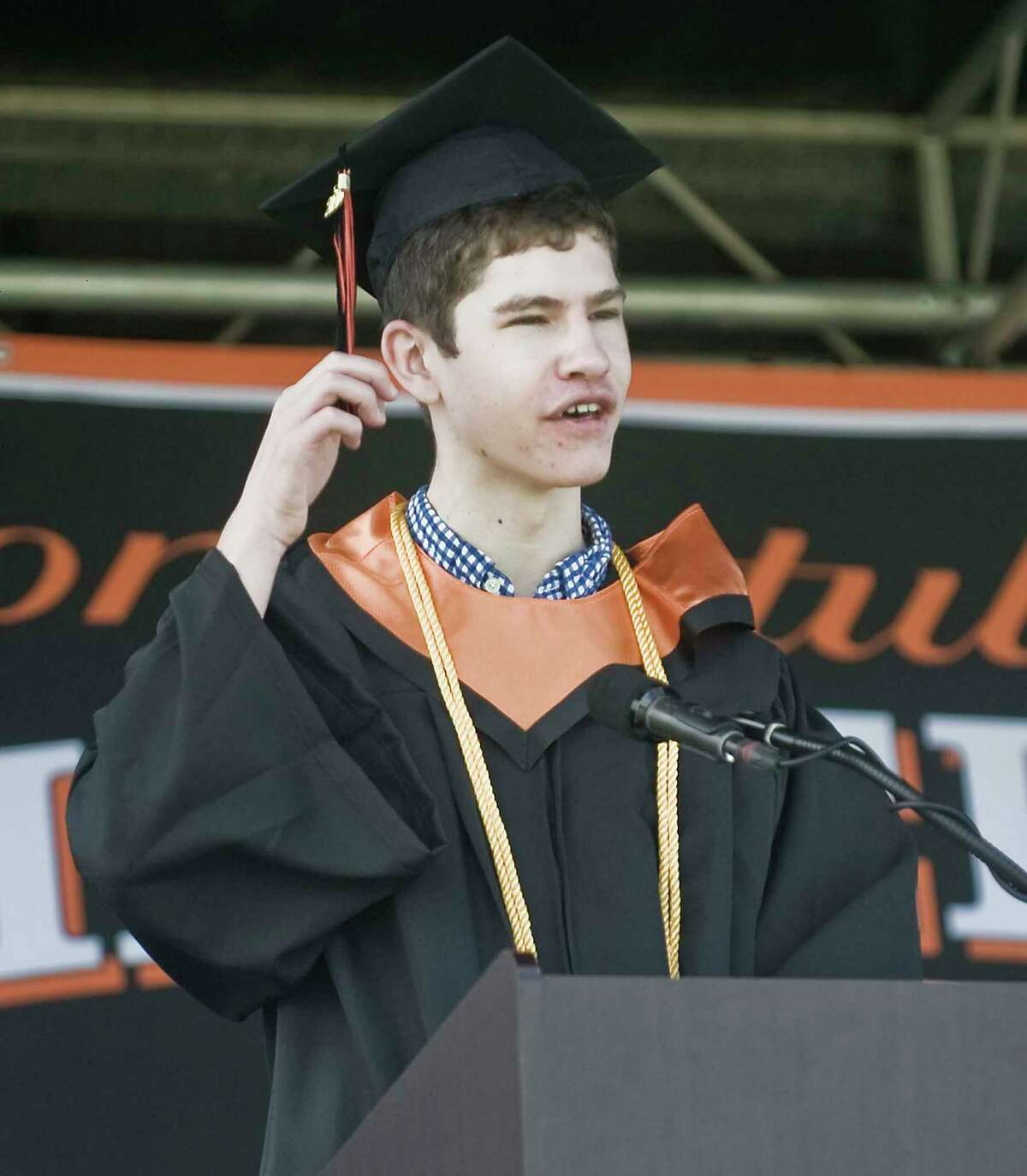 Ridgefield High School Valedictorian, Questin McQuilkin, speaks to the students during the graduation ceremony held on the school grounds. Thursday, June 18, 2020