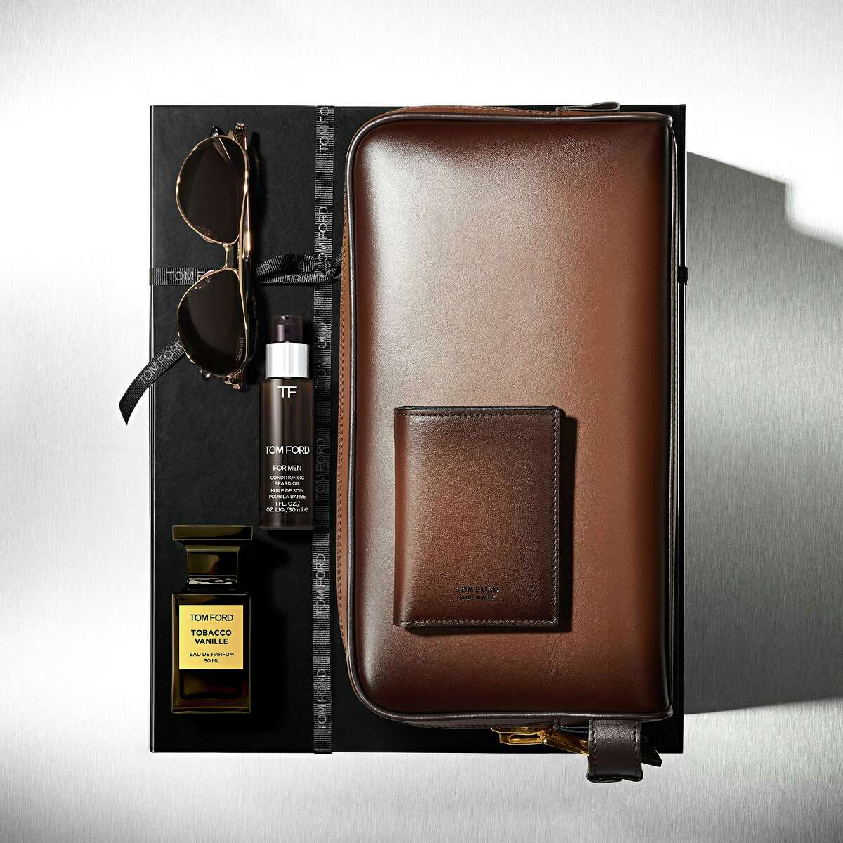 Tom Ford has created exclusive Father's Day gifts including this Tobacco Vanille Luxe Set that includes Tobacco Vanille cologne and beard oil (think of a scent that suggests an opulent English gentleman's club), sunglasses, and burnished leather toiletry bag and folding card holder; $2,775 at tomford.com for delivery to Tom Ford, Galleria.