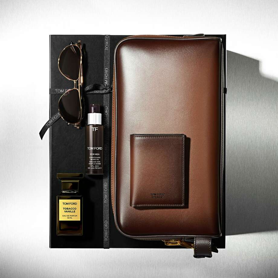 Tom Ford has created exclusive Father's Day gifts including this Tobacco Vanille Luxe Set that includes Tobacco Vanille cologne and beard oil (think of a scent that suggests an opulent English gentleman's club), sunglasses, and burnished leather toiletry bag and folding card holder; $2,775 at tomford.com for delivery to Tom Ford, Galleria. Photo: Tom Ford / Tom Ford