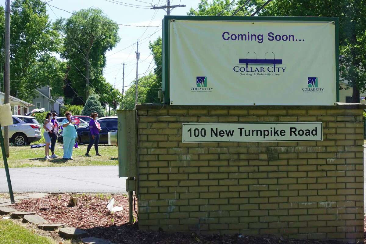 Workers from Diamond Hill nursing home stand at the entrance of the nursing home to take part in a rally on Thursday, June 18, 20202, in Schaghticoke, N.Y. Workers, who are without a contract, say that they have concerns over the home's operations during the pandemic. (Paul Buckowski/Times Union)