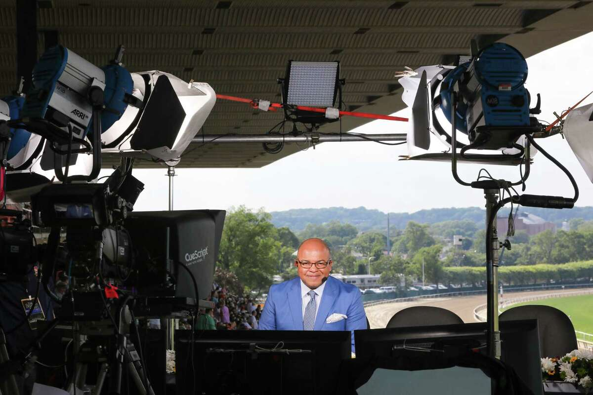 FILE -- Mike Tirico in the NBC booth before calling the Belmont Stakes at the Belmont Racetrack in Elmont, N.Y., June 10, 2017. Tirico replaces Bob Costas for NBCa€™s Olympics coverage, but he insists a€œIa€™m not famousa€ and is uncomfortable with questions about his background. (Uli Seit/The New York Times) ORG XMIT: XNYT19