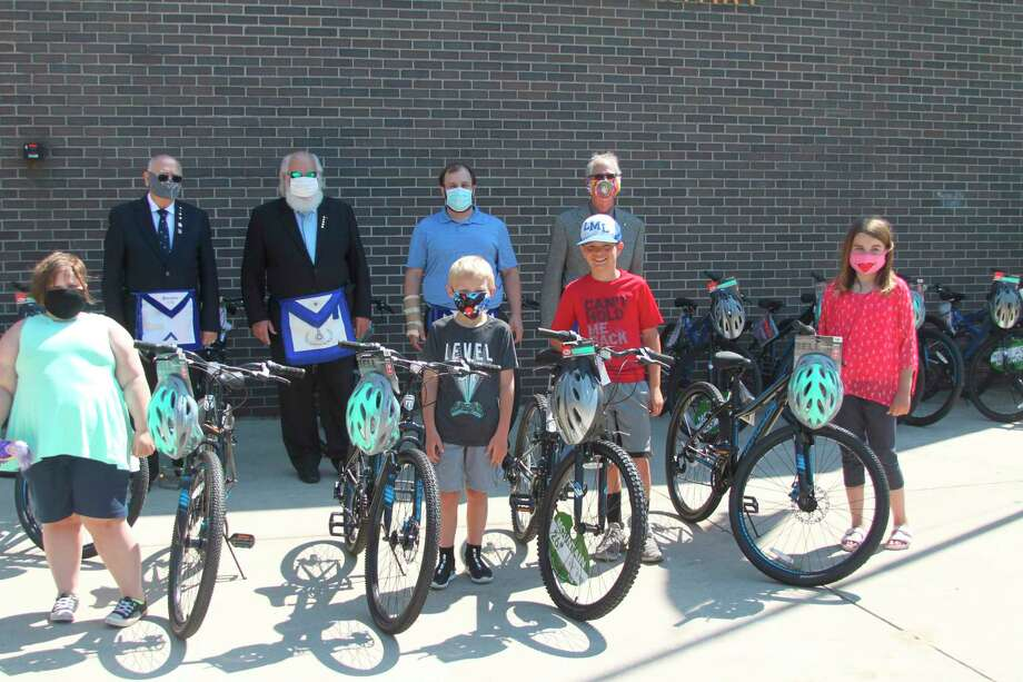 The Manistee Lodge No. 228 of Free and Accepted Masons gave away new bikes to Kennedy and Jefferson Elmentary School students on Wednesday as part of their annual Bikes for Books Program. The program encourages students to read more to be entered into a drawing for a new bike. (Ken Grabowski/News Advocate)