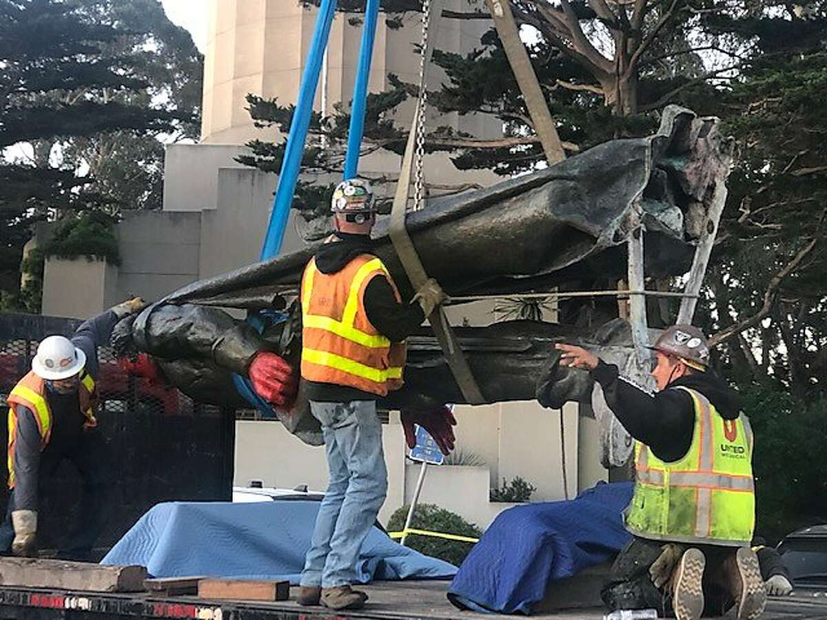 A crew removes the statue of Christopher Columbus at Coit Tower on June, 18, 2020 in San Francisco Calif.