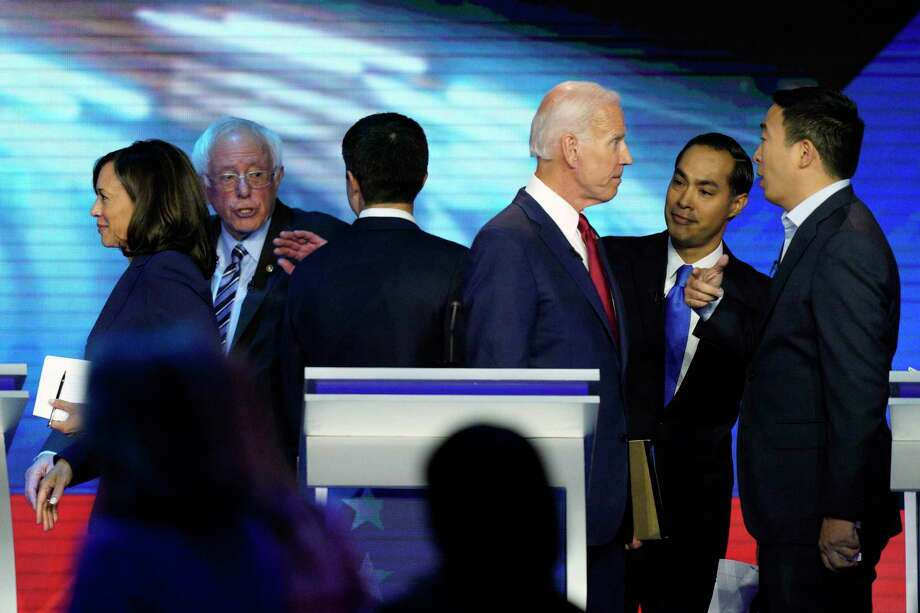 Democratic presidential hopefuls former Vice President Joe Biden and Sen. Kamala Harris head off in different directions at the finish of a candidates' debate in Houston in September 2019. Others pictured are former San Antonio Mayor Julián Castro and Andrew Yang, right, and Sen. Bernie Sanders and South Bend Mayor Pete Buttigieg. Photo: David J. Phillip /Associated Press / The Associated Press