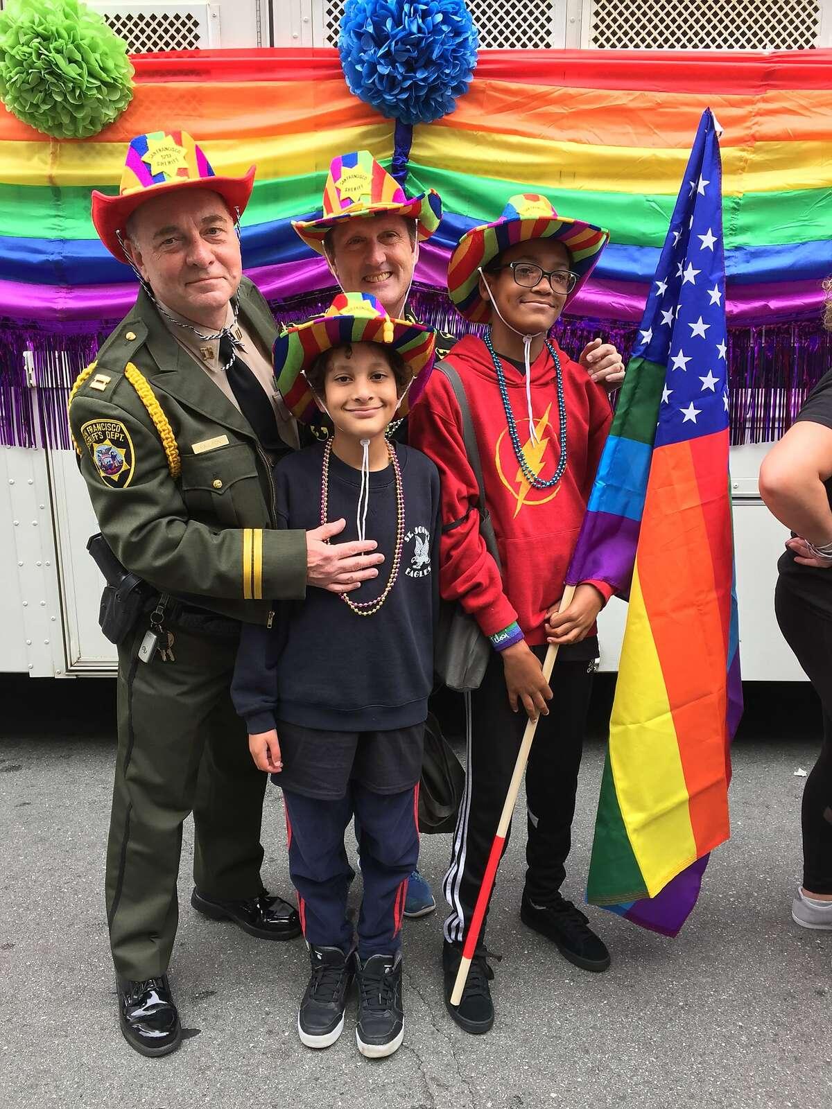 The Fisher-Paulson family enjoying San Francisco Pride.