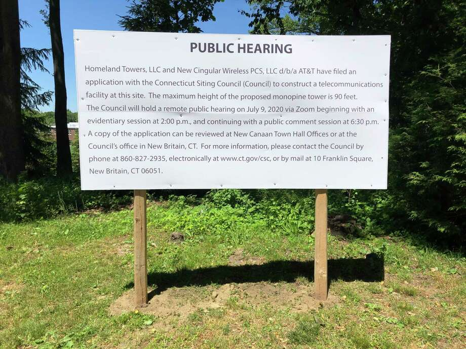 A sign alerts passers-by to the July 9 hearing on the proposed cell tower on Soundview Lane. Photo: Contributed Photo / New Canaan Advertiser Contributed