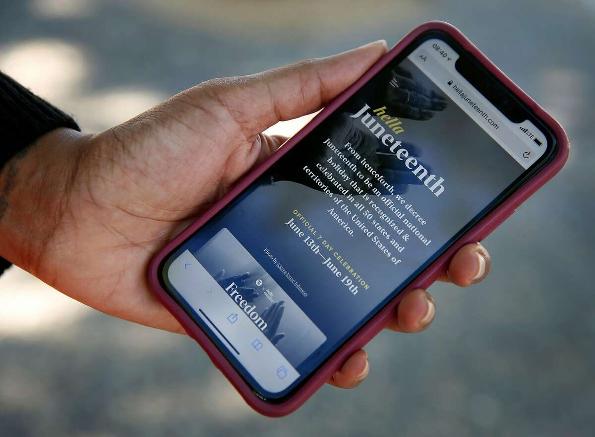June Johnson accesses the Hella Junteenth app, which she helped develop, in San Francisco, Calif. on Thursday, June 18, 2020.