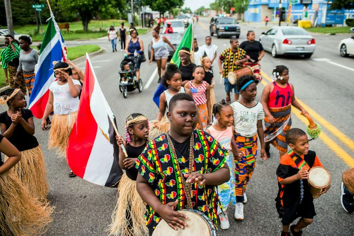 In this June 19, 2018, file photo, Zebiyan Fields, 11, at center, drums alongside more than 20 kids at the front of the Juneteenth parade in Flint, Mich. Juneteenth celebration started with the freed slaves of Galveston, Texas. Although the Emancipation Proclamation freed the slaves in the South in 1863, it could not be enforced in many places until after the end of the Civil War in 1865.
