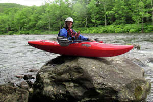 Outdoors columnist Herb Terns has a lot to learn about whitewater kayaking. He goofs around before performing a rock entry into the Deerfield River. (Courtesy of Herb Terns)