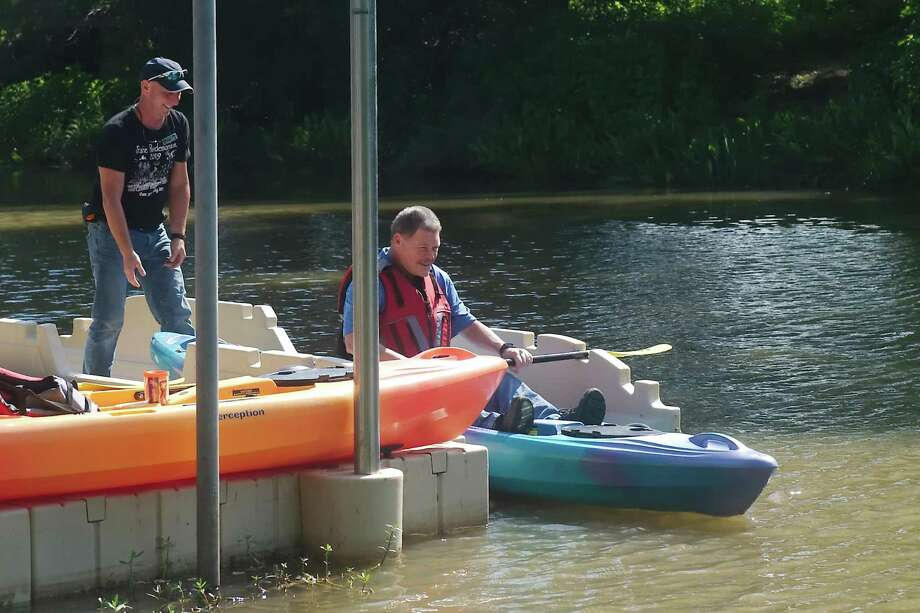 Armand Bayou Nature Center Executive Director Tim Pylate helps Pasadena District H City Council member Thomas Schoenbein prepare to launch a kayak from a new platform at Big Island Slough Park. Photo: Kirk Sides / Staff Photographer / © 2020 Kirk Sides / Houston Chronicle
