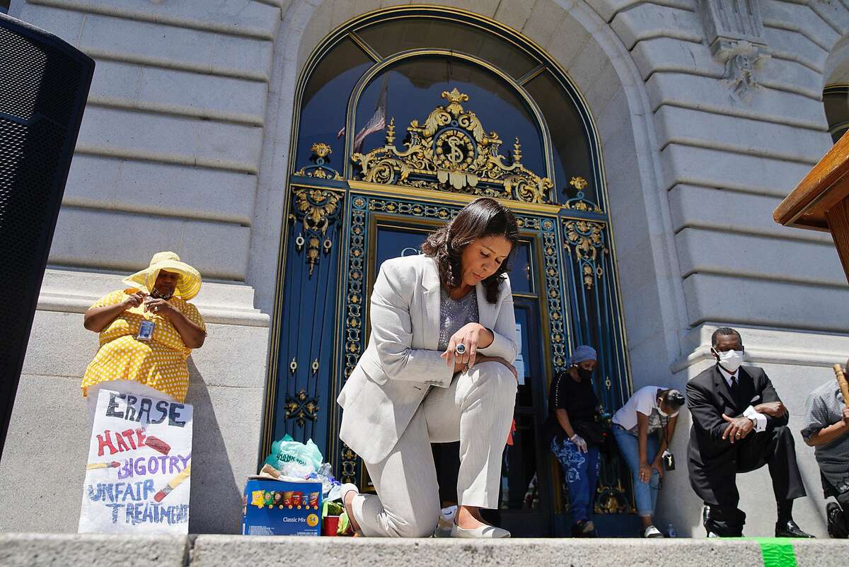 San Francisco Mayor London Breed on a knee for eight minutes and forty six seconds in honor of George Floyd at City Hall on Tuesday, June 9, 2020, in San Francisco, Calif. Black Lives Matter demonstrations continued in the wake of the death of George Floyd, who was killed in Minneapolis police custody.