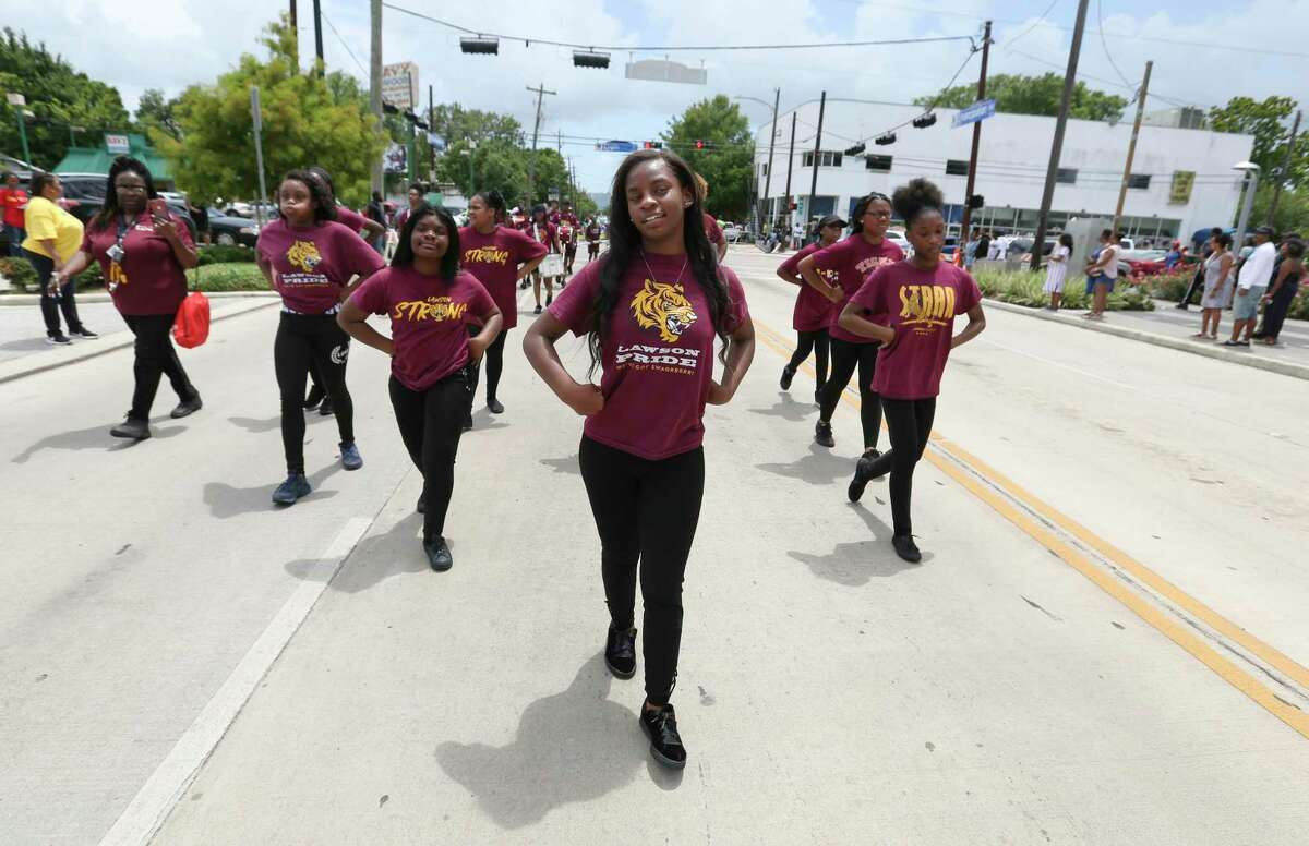 The Lawson Academy students participate in the Juneteenth Parade as they march past Emancipation Park on Saturday, June 15, 2019, in Houston.