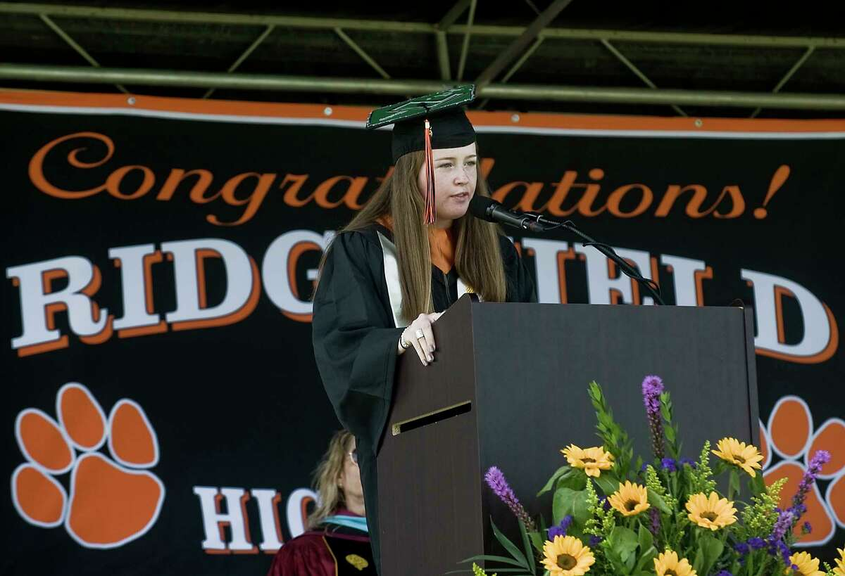 Ridgefield High School Class President, Clodagh Ryan, addresses the students during the graduation ceremony held on the school grounds. Thursday, June 18, 2020. In her speech to her peers, class President Clodagh Ryan admitted this wasn't the graduation they expected, but