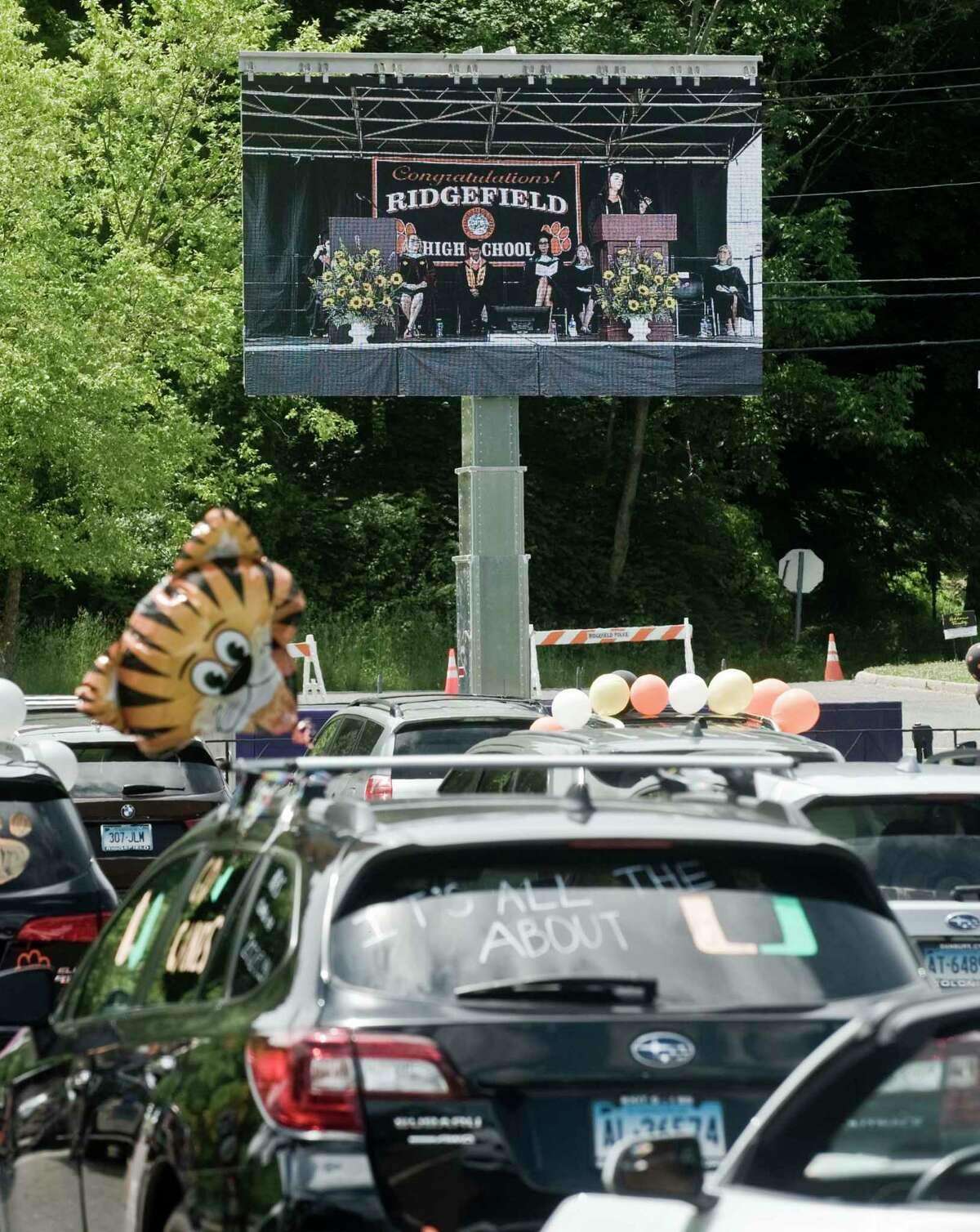 The 2020 Ridgefield High School graduation ceremony was broadcast on big screens in the school parking lot for graduates in their cars. Thursday, June 18, 2020.