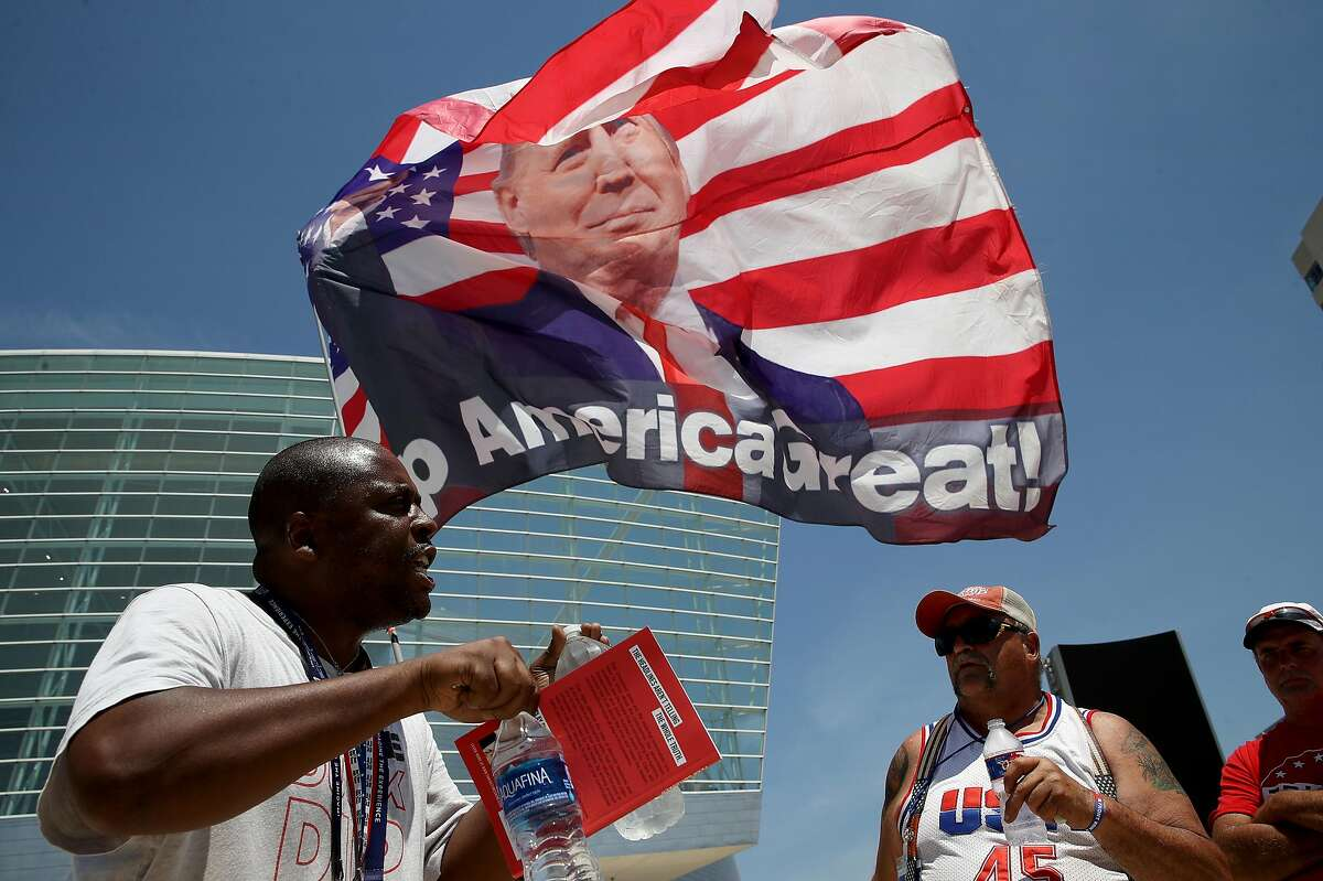 Nicholas Winford (left) debates Trump supporter Randall Thom (right), on the racial policies of U.S. President Donald Trump outside the BOK Center June 18, 2020 in Tulsa, Oklahoma. Trump is scheduled to hold his first political rally since the start of the coronavirus pandemic at the BOK Center on Saturday while infection rates in the state of Oklahoma continue to rise.
