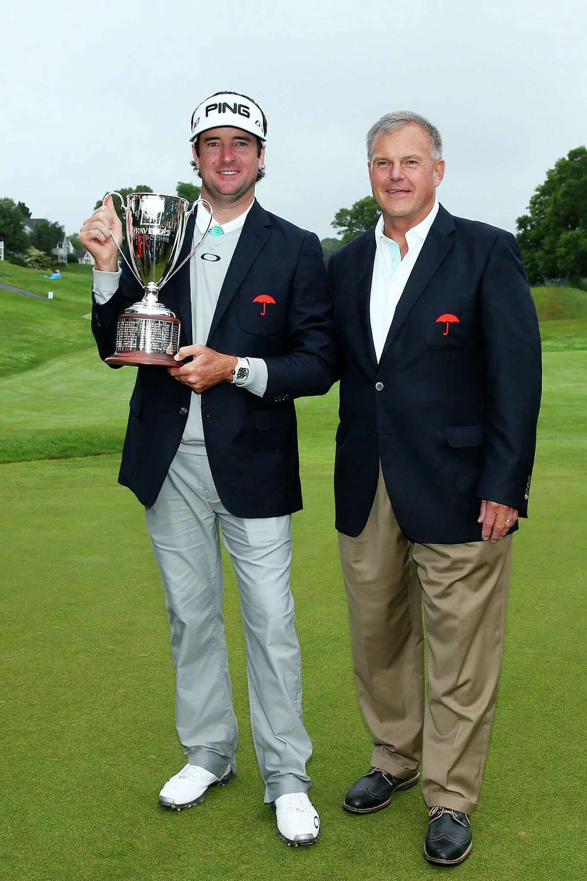 CROMWELL, CT - JUNE 28: Bubba Watson and Travelers executive Andy Bessette after the final round of the Travelers Championship at TPC River Highlands on June 28, 2015 in Cromwell, Connecticut. (Photo by Jim Rogash/Getty Images)