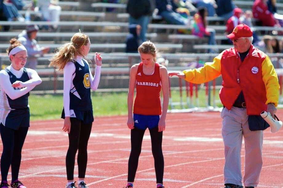 Chippewa Hills' Don Foreman (right) lines up girl runners during a track meet in a recent season. (Courtesy photo)