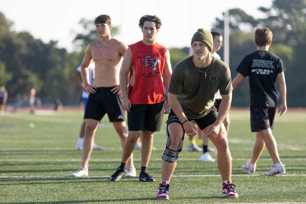 Student athletes train during a strength and conditioning session at Tomball High School, Wednesday, June 17, 2020.