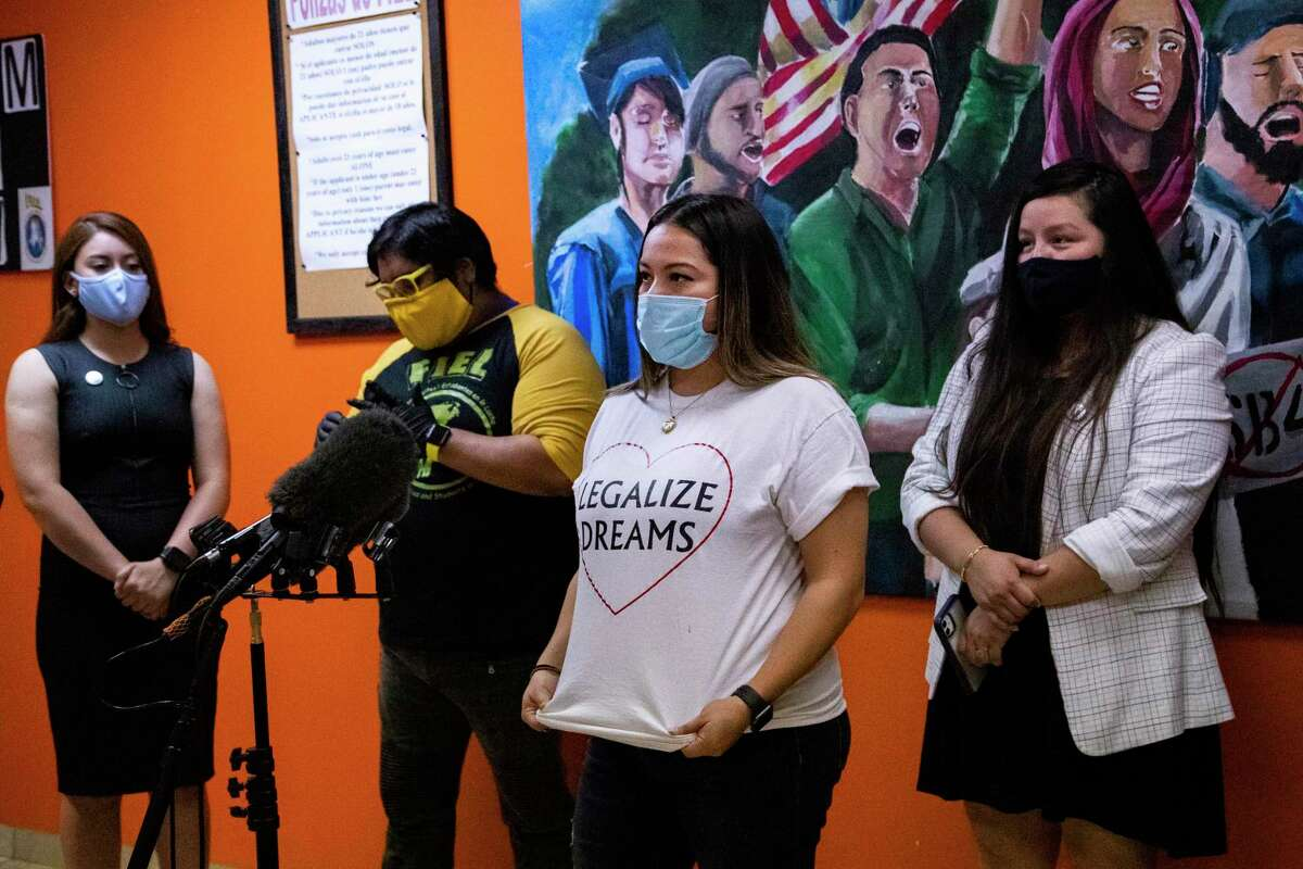 Karen Ramos, 31, emphasizes the message on her T-shirt that says