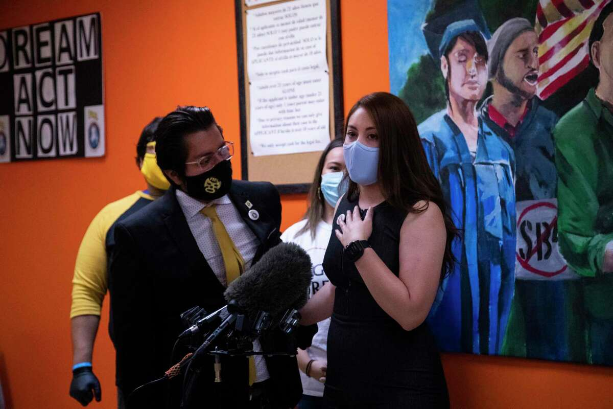 Devani Gonzalez, 23, places her hand on her chest as she talks about her experience as a DACA recipient during a press conference on Thursday, June 18, 2020, in Houston. The press conference was scheduled in light of the Supreme Court decision to uphold the Deferred Action for Childhood Arrivals program.