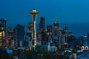 SEATTLE, WA - NOVEMBER 4: The sun sets on the Space Needle and downtown skyline as viewed at dusk on November 4, 2015, in Seattle, Washington. Seattle, located in King County, is the largest city in the Pacific Northwest, and is experiencing an economic boom as a result of its European and Asian global business connections. (Photo by George Rose/Getty Images)